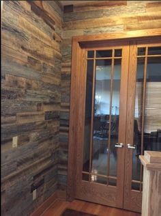 What a great use of #Original style #ArtisWall ! It gives this home a #rustic feel! #reclaimed #reclaimedwood #woodwall