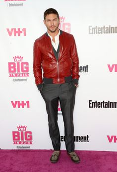 Adam Senn Makes a Red Statement in Leather Bomber Jacket