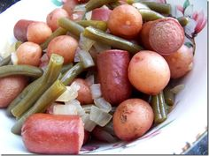 Sausage, Green Beans, and Potatoes ... 1 lb fresh green beans; 1 lb baby red potatoes; 1/2 lb smoked sausage links or all-beef hot dogs; 1 vidalia onion, chopped; 2 garlic cloves, minced; 4-6 cups chicken broth; salt and pepper to taste ... slow cook on low for 8-10 hours