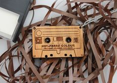 Wood laser cut pendant necklace Retro cassette tape on stainless steel chain. $25.00, via Etsy.