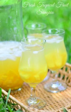 This drink is like summer in a glass! Delicious Light Sangria made with fresh pineapple, fresh mango, coconut rum, dry wine and Sweet'N Low.