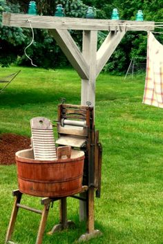 an old red painted tub with scrub board, on a wringer washstand, stand ready for wash day. early glass insulators lined up on the clothesline post, reminiscent of the old telephone poles. Country Farm, Country Life, Country Living, Country Decor, Deco Nature, Wash Tubs, Glass Insulators, Electric Insulators, Vintage Laundry