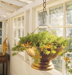 Hanging planter with colander.  Clever idea