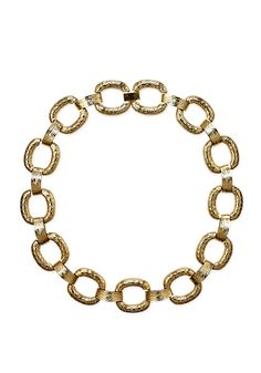 Not sure how to accessorize a yellow top? Try this chain link necklace in hammered gold.
