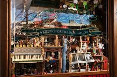 Spot the mice characters. Huge holiday Mouse House in window from Castle in the Air. A magical shop in Berkeley, CA.
