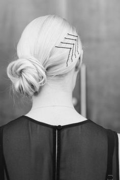 Try this bobby pin arrow idea for a unique touch on a classic updo this NYE