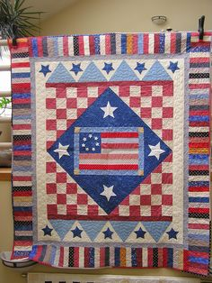 Especially like the lt. blue points with stars border and how it changes the square  of the quilt to a rectangle.