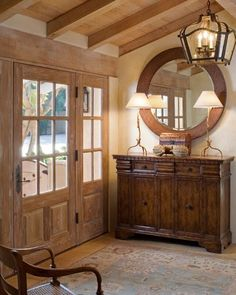 foyer - love the round mirror and window-paned doors