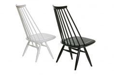Mademoiselle arm chair by Finnish designer, Ilmari Tapiovaara in 1956.