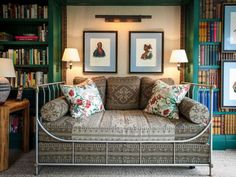 daybed in library with chintz pillows ~ David Netto design