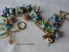 Beaded Bracelet Lampwork Beads, Blue Agate and Crystals. $57.00, via Etsy.