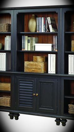 "2 Door Wall Bookcase Ravenwood Antique Black Width: 32"" Height: 72"" Depth: 14"" This 2 door bookcase is the perfect home furnishing for any booklover. Constructed of hardwood solids and Oak veneers, it boasts an antiqued black finish that has a tastefully weathered appearance with an adjustable shelf behind the two doors."