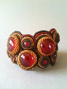 Red, Gold & Brown Bead Embroidered Cuff by Jeka Lambert.  Glass cabochons, 1920s nailhead beads, seed beads.
