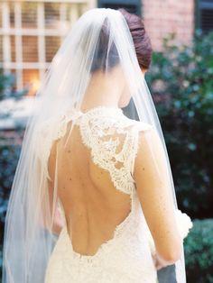 Gorgeous open back lace wedding dress: http://www.stylemepretty.com/north-carolina-weddings/chapel-hill-north-carolina/2015/11/23/traditional-carolina-inn-wedding/   Photography: Nancy Ray Photography - http://nancyrayphotography.com/