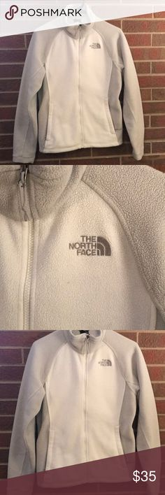 North Face Full Zip Fleece Jacket North Face Full Zip Fleece Jacket  Features pockets and zips fully up to the neck  This jacket is in good condition however may show signs of wear and minor pilling due to the nature of its color and material. Minor dot near logo where fleece is missing in a tiny spot. Please see photos or ask questions about condition prior to purchase. The North Face Jackets & Coats