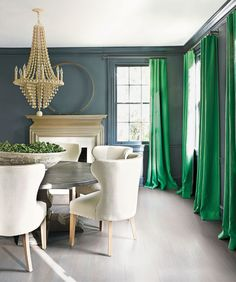 For neutral walls that feel anything but, go dark with charcoal. According to Leatrice Eiseman, executive director of the Pantone Color Institute, gray makes any bright color feel sophisticated — case in point, the happy-go-lucky green on the curtains here. Opt for a matte finish, and also paint the moldings to create a seamless, velvety backdrop that allows the drapes and the rest of the furnishings to really stand out.