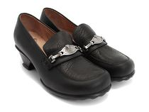Fluevog shoes: black leather loafers with small heel and what looks like heavy-tread soles