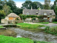 Upper and Lower Slaughter, Cotswolds, England - Sep 2009. I love that you drive through the river to get to your house. this happened all over the area.