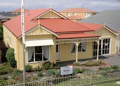Highview Homes 'Lilac' with a roof made from COLORBOND® steel in Manor Red®.