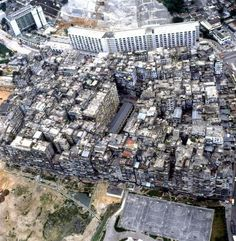 """""""The Kowloon Walled City was located just outside Hong Kong, China during British rule. A former watchpost, it was occupied by Japan during World War II and subsequently taken over by squatters after Japan's surrender. Neither Britain nor China wanted responsibility for it, so it became its own lawless city."""""""
