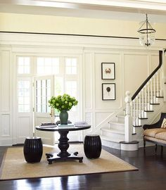 Oh my, what a foyer! Love the gardenstools. Floor would look amazing in black…