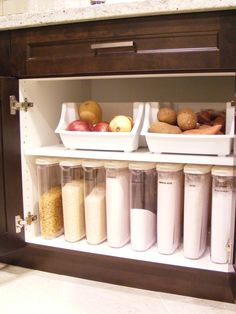 separate bins for potatoes and onions, tall narrow containers for flour, etc., and having it all under the counter. so organized.