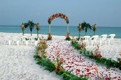 the floor could be covered with flower petals and the area where the bride is walking could be like in the picture.