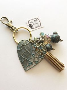 A personal favorite from my Etsy shop https://www.etsy.com/listing/516096105/pretty-open-patina-heart-with-accent