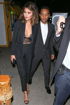 Loved-up: Chrissy Teigen and John Legend were celebrating their seven-year romance in style with a Valentine's Day dinner date at Giorgio Baldi in Santa Monica on Tuesday
