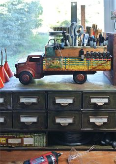 vintage metal toy trucks with an old cigar box in the bed and a wire test tube rack tucked inside of that. This set-up holds items upright that I such as small clamps, rulers, scissors, craft knives, Sharpies and more. Craft Room Storage, Craft Rooms, Vintage Toys, Vintage Metal, Vintage Trucks, Vintage Industrial, Industrial Design, Vintage Style, Studio Organization