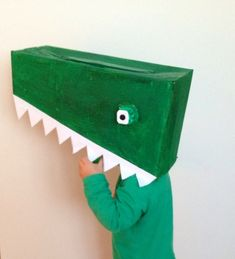 Here's how to make a crocodile costume from a cardboard box and egg carton. It's ideal for an animal dress up party or just to play with at home.