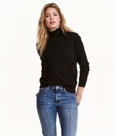 Black. PREMIUM QUALITY. Long-sleeved, fine-knit turtleneck sweater in merino…