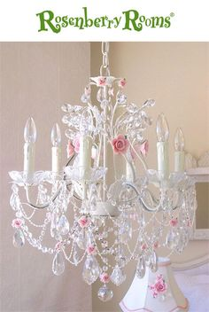The 6 Light Crystal Chandelier with Pink Porcelain Roses is exceptional, large and sparkly.  This chandelier has been painted antique white and is adorned with the most delicate pale pink porcelain roses in full bloom
