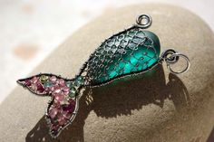DEEP TEAL mermaids tail wire wrapped seaglass pendant.. $176.00, via Etsy.