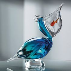Pelican with 3fish in mouth in solid #glass entirely #handmade in the furnace submerged in the aquamarine and green glass.