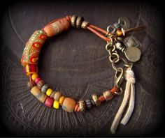 African Beads,Leather Cord, Kuchi Charms, Glass, Charm Bracelet by YuccaBloom on Etsy https://www.etsy.com/listing/222781601/african-beadsleather-cord-kuchi-charms