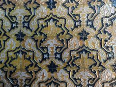 This is a tiled wall in the Plaza de Espana, in Seville, Spain. Built for the World Fair exposition, these tiles reflect a key Spanish cultural tradition and are an example of its artistry. World's Fair, Gaudi, Tile Patterns, Whimsical, Tiles, Seville Spain, Traditional, Rugs, Spanish
