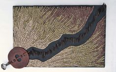 """""""Heat (Each decade hotter than the last)"""" by Julie Sperling (2014) -- stone from Ontario, Quebec, and Pennsylvania & a flue damper. First #mosaic in a series about #climate change."""