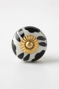 Anthropologie - Beautiful.  Thinking about these knobs for my laundry room cabinets...