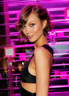 Karlie Kloss shows how versatile a bob can be. She added waves, a deep side part, and pinned back the shorter side. This look works for all hair lengths, really.