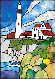 Love this.. Lighthouse and rocks in stained glass.