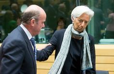 epa04813841 International Monetary Fund Managing Director Christine Lagarde (R) and Spanish Minister of Economy Luis de Guindos (L) at the start of a special Eurogroup finance ministers meeting on Greece, in Brussels, Belgium, 22 June 2015. Progress has been made in bailout negotiations with near-bankrupt Greece, but 'we are not yet there,' European Commission President Jean-Claude Juncker said ahead of an emergency summit of eurozone leaders. EPA/OLIVIER HOSLET
