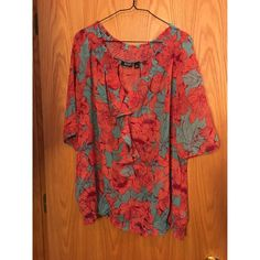 a.n.a. Flower Print Blouse Only wore twice. Great condition. It's not sheer but a sheer and light material. Perfect for spring and summer. It's a shade darker of coral and a pretty blue print. a.n.a Tops Blouses