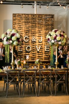 American Spirit Works Stave Room wedding reception, rustic backdrop with bride and groom's initials in lights