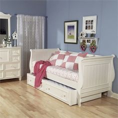 The Beach Cottage Day Bed features a cottage style design with beach inspired elements such as the bead board headboard and footboard!