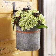 Decorative Bucket on Door Seasonal freshness comes courtesy of live hydrangea and hypericum in this hanging bucket. Simply attach a decorative hook to your door and hang an antique bucket filled with water and the fall blooms. Hortensia Hydrangea, Hydrangeas, Deco Floral, Front Entry, Front Porch, Front Doors, Flower Boxes, Flower Ideas, Autumn Inspiration