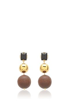 These **Marni** earrings are rendered in wood and methacrylic and feature a tri-color streamlined design.