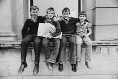 A group of newspaper vendors pose for a photograph, Ireland, circa Get premium, high resolution news photos at Getty Images White Privilege, Genealogy, Newspaper, Old Photos, 1980s, Ireland, Irish, Strong, Poses