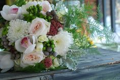 Wedding Bouquet - White orchids, white football mums, blush garden roses, green hypericum berries, gray brunia berry, sedum, dusty miller, green button mums, white spray roses, plumose  Crystal Springs Florist  Benton Harbor Michigan