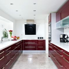 Inspired by real-life kitchen makeovers? Take a look at this modern burgundy kitchen from Beautiful Kitchens magazine with stainless steel appliances and high-gloss units. Check out Housetohome for plenty more kitchen ideas Life Kitchen, Red Kitchen, Black Kitchens, Kitchen Decor, Modern Kitchen Cabinets, Modern Kitchen Design, Concrete Kitchen, Kitchen Flooring, Living Room Decor Cozy